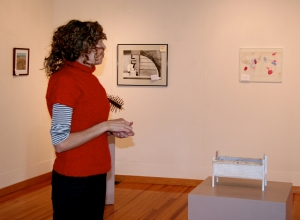 Exhibition Committee Chairman Meredith Rosier surveys the Main Gallery.