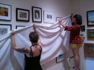 Interns Kristy and Jessica prepare Little Gems for Saturday's unveiling.