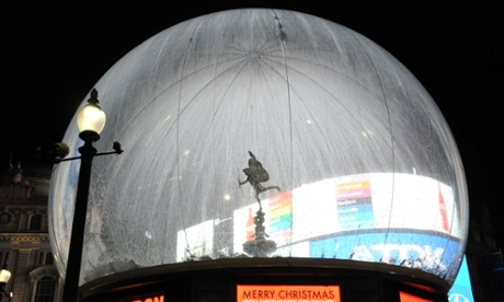 Snow globe … The statue of Eros at Piccadilly Circus has been housed in an inflatable PVC bubble to protect it from vandals over the holiday season. Photograph: John Keeble/Getty Images