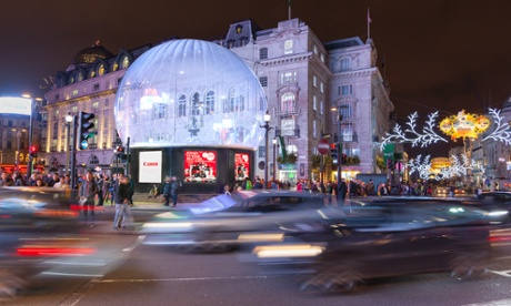 Festive fulcrum … traffic swirls around the base of the Eros snow globe. Photograph: Wildstone/Westminster City Council