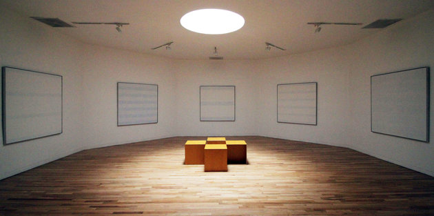 "This Feb. 13, 2012 photo shows American abstract painter Agnes Martin's works hanging in a special octagonal gallery at the Harwood Museum of Art in Taos, N.M. The exhibition ""Agnes Martin: Before the Grid"" opens at the museum Feb. 25, 2012. (AP Photo/Susan Montoya Bryan)"