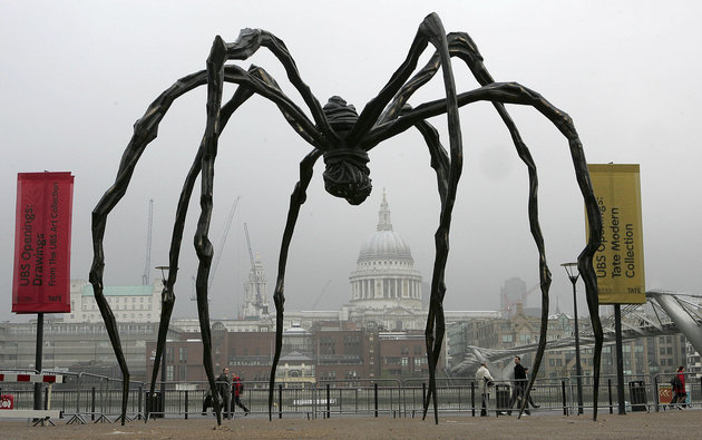 FILE - In this Oct. 3, 2007 file photo, French-born artist Louise Bourgeois' sculpture of a giant spider, Maman 1999, stands outside the Tate Modern in London. The sculpture, one of a series of six, is more than nine metres high and made of bronze, stainless steel and marble. Her studio's managing director says artist Louise Bourgeois has died in New York City, after a lengthy career of exploring women's deepest feelings on birth, sexuality and death. She was 98. Wendy Williams of Louise Bourgeois Studio says the sculptor died at Beth Israel Medical Center on Monday, May 31, 2010 two days after suffering a heart attack. (AP Photo/Nathan Strange, File)